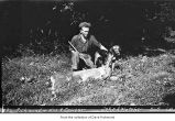 Earl Richmond and a dog near a dead cougar near South Fork Hoh River