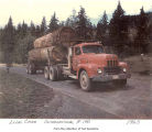 Loaded log truck on a dirt road, probably on the Olympic Peninsula