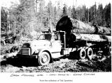 Log truck loaded and parked in woods, probably on the Olympic Peninsula