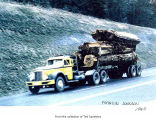 Loaded log truck driven along a road probably in or near Port Angeles