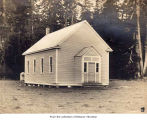 Building, possibly a schoolhouse or church, probably on the Olympic Peninsula