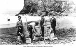 Smelt fishermen and children at Ruby Beach, Jefferson County