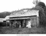 People outside the house on the Merchant Maybury homestead, Clallam County