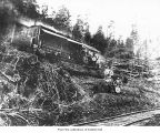Merrill and Ring Logging Company logging crew with a diesel donkey engine, Clallam County