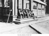 Men outside a telegraph office and post office, probably in Clallam County