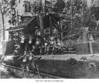 Merrill and Ring Logging Company logging crew with a donkey engine, probably in Clallam County