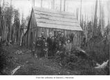 Lyre River School with students and teachers posing outside building, Clallam County