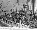 Deck of ship crowded with passengers headed for Nome, June 1906