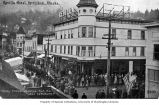 Crowd watching possible July 4th parade in front of Revilla Hotel, Ketchikan, n.d.