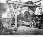 Heavy dredge cylinder being loaded on Front Street, Dawson, n.d.