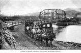 Orr and Tukey's horse-drawn stage, on the Ogilvie Bridge over the Klondike River near Dawson, n.d.