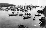 Fishing boats in harbor, unknown location, ca. 1920