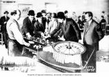 Men playing roulette at the Double O casino in Skagway, 1898