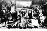 Display of pelts and hunting trophies inside a cabin, Alaska,, n.d.