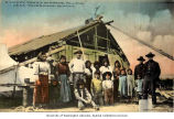 Native family group in front of dwelling near Fairbanks, n.d.