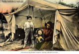 Native woman with her two children, probably Athabascan outside their summer camp on the Tanana...