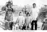 Eskimo men with children and a dog, location unknown, n.d.