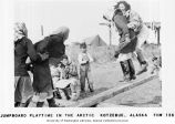 Eskimo children playing on jump board, Kotzebue, ca. 1965