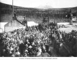 Last spike for the White Pass and Yukon Railroad driven at Caribou Crossing (now Carcross),...