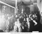 Gambling house interior showing men crowded near a gaming table, Dawson, May 31, 1901