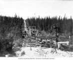 Mining operation at claim Nos. 3-4 at Last Chance showing gravity tram in use, Yukon Territory,...