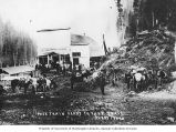 Pack train preparing to leave from dry goods store, Avery, Idaho, 1910
