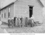 Children with teacher outside schoolhouse at Dry Creek Ridge, near Troy, Idaho, 1901