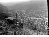 Bird's-eye view of Wallace showing an automobile on a dirt road in foregound, Idaho, ca. 1910