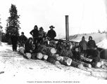 Workers and lumber probably from the Wild Goose Mining and Trading Company's mill on Duncan Creek,...
