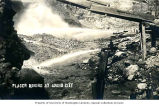 Placer mining showing sluicing with hydraulics, Idaho City, ca 1920