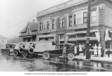 Automobile and trucks in front of the Viking Bakery Co., corner of E. Stark and E. 13th Streets,...
