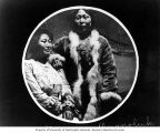 Eskimo women Nora Oo-teen'a and her sister Ongnoluk wearing European dresses, Cape Prince of...