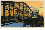 Streetcar and carriages crossing the Willamette River on the Morrison Street Bridge, Portland,...