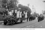 Flower-covered truck leading a street parade in Silverton, Oregon, ca. 1915
