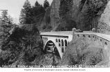Automobiles parked on Shepperd's Dell Bridge on the Columbia River Highway near Bridal Veil,...