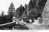 Automobile parked on Shepperd's Dell Bridge on the Columbia River Highway near Bridal Veil,...