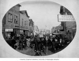 Crowded scene on Front Street showing the Gold Belt Dance Hall and Madden House, Nome, ca. 1901