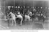 Man changing horses in a relay race at the Round-Up, Pendleton, Oregon, ca. 1910