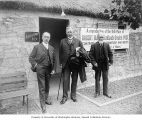 Committee members in front of the Burns Cottage at the Lewis and Clark Exposition, Portland,...