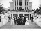 Commissioners and their wives outside the New York State Building at the Lewis and Clark...