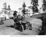Men in automobile touring the grounds of the Lewis and Clark Exposition, probably under...