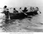 Kingikmiut Eskimos paddling an umiak, a boat made of animal skins, during a whale hunt, Bering...