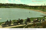 Automobiles driving around Shoal Bay near Victoria, British Columbia, ca. 1905