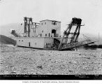 Bear Creek gold mining dredge, probably belonging to the Canadian Klondike Mining Company,...