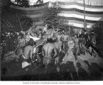 Igorrote men dancing and playing drums at the Igorrote Village, Lewis and Clark Exposition,...
