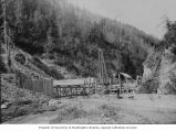End of the spillway for the Porcupine Gold Mining Company flume, as seen from the river bed,...
