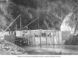 Porcupine Gold Mining Company flume showing men working on the walls of the spillway and intake,...