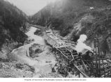 Porcupine Gold Mining Company flume under construction showing workers laying stringers and sills,...