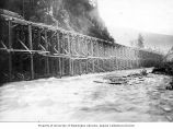 Porcupine Gold Mining Company flume below Station No. 1 showing lumber posts and spills along the...