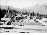 Porcupine Gold Mining Company flume under construction showing unfinshed buildings in the...